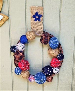 Americana Ball Wreath - finished wreath hanging on exterior wall