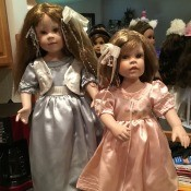 Identifying Porcelain Dolls - dolls sitting in front of mirror on a dresser