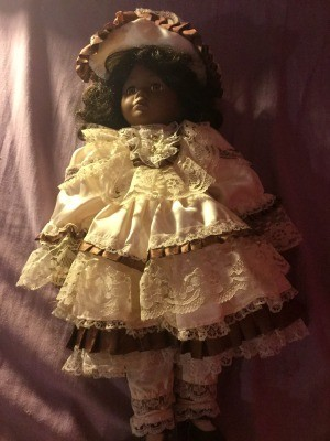Identifying a Porcelain Doll - black doll with ecru lace dress and hat trimmed with brown ribbon