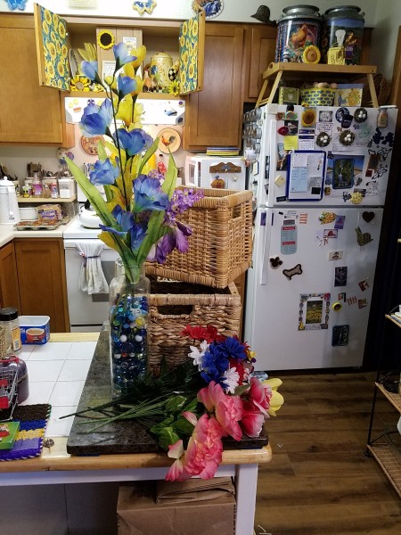 Double Decker Wicker Baskets Floral Display -baskets and flowers on kitchen table