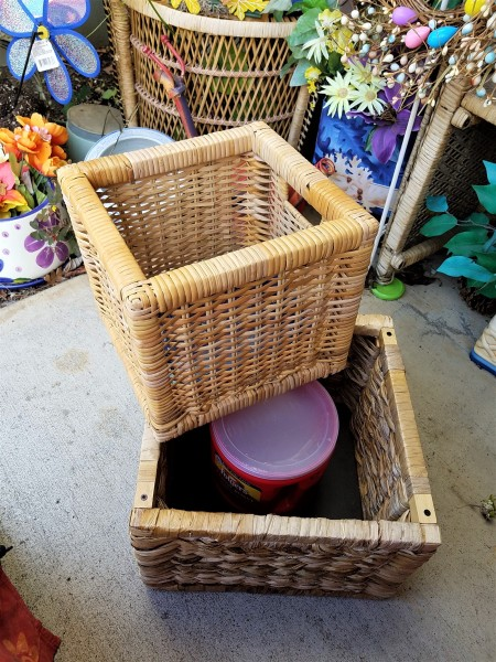 Double Decker Wicker Baskets Floral Display - coffee canister inside the larger basket with the small basket sitting across one corner