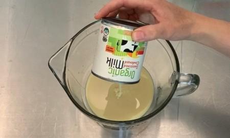 Adding sweetened condensed milk to mixing bowl.