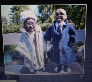Buying Milton Porcelain Doll Shoes? - photo on computer screen of male and female African American Dolls
