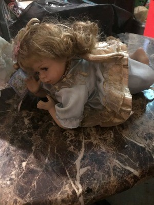 Value of a Cathay Porcelain Doll? - doll on stone countertop