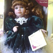 Identifying a Collector's Choice Porcelain Doll? - doll in blue velvet dress with fluffy white trim, in the original box