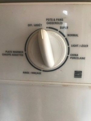 When Is detergent Cup Supposed to Open? - closeup of control knob