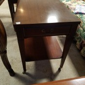 Value of a Pair of Mersman End Tables? - mahogany finish plain table with lower shelf, drawer, and casters, rectangular in shape