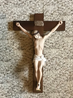 What Is the Value of an Armani Crucifix? - crucifix lying on carpet