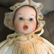 Identifying a Porcelain Doll? - doll wearing a christening dress and bonnet, closeup of the face