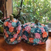 Yo Yo Covered Papier-mâché Pumpkins - pumpkins on antique oak cabinet next to potted orchids