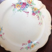 Homer Laughlin Pattern  Identification? - white plate with fancy edge and one large and two smaller floral designs