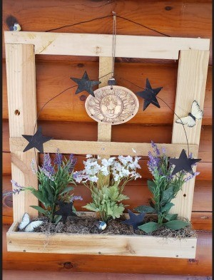 Decorative Junk Wood Window Frame - scarp shipping wood packaging made into a window with a flowerbox decoration