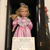 Value of an Ashley Belle Doll? - doll wearing a pink dress in a black wooden case