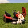 A riding lawnmower in need of repair.