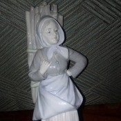 Identifying a Ceramic Figurine - nearly monochromatic figurine of a woman carrying firewood on her back