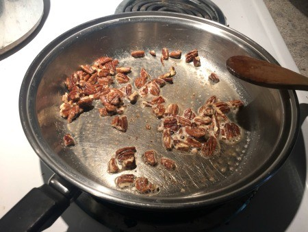 Cooking butter pecan in a frying pan.
