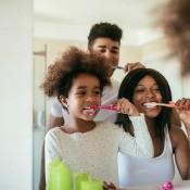 A family brushing their teeth.