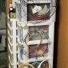Hanger, Clips, and Rings for Craft Storage - wreath rings and embroidery hoops hanging from a hanger