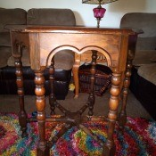 The side of the wooden octagon table.