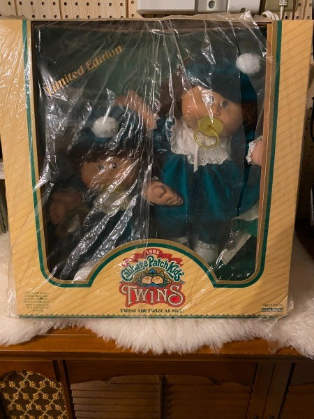 Two Cabbage Patch dolls in the box.
