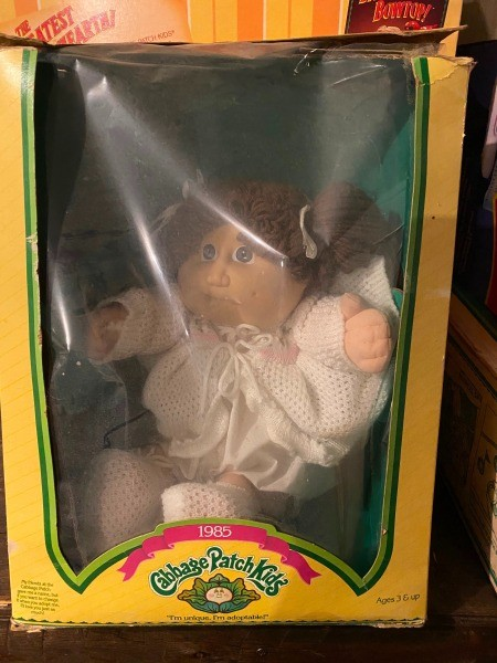 A Cabbage Patch doll in the box.