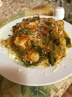 A plate of chicken pesto pasta