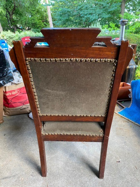 The back of an antique chair.