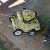 An old yellow lawnmower.