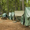 A collection of Boy Scout tents at camp.
