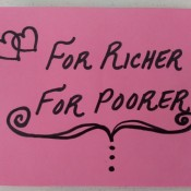 "A card that says ""For Richer, For Poorer"" on pink paper"