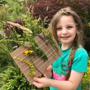 Nature Weaving - child holding his creation