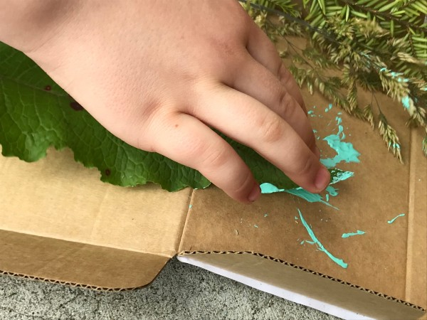 Natural Paint Brushes - dipping leaf in light blue paint