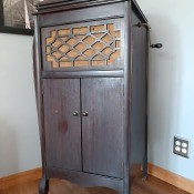 Identifying an Antique Crank Record Player? - dark wood antique record player with a hand crank