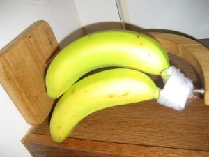 Wrap Banana Stems in Plastic - stem of bananas wrapped in plastic