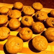 The muffins cooling on a cutting board.