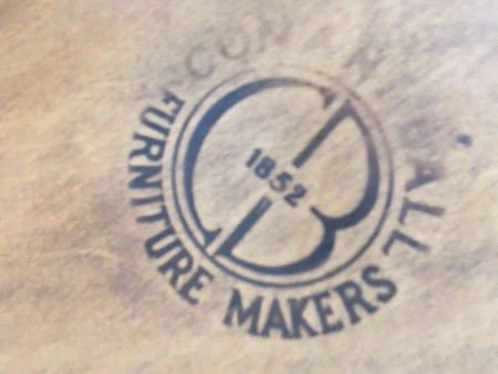 A manufacturer's marking on a dining set.