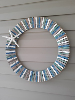 A clothespin with a summery beach theme.