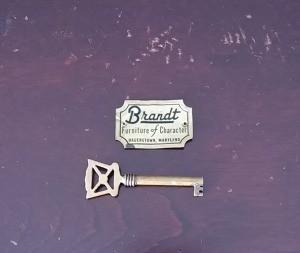 A Brandt plaque next to a key.