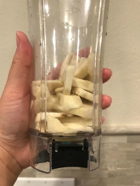 Sliced fruit in a blender.