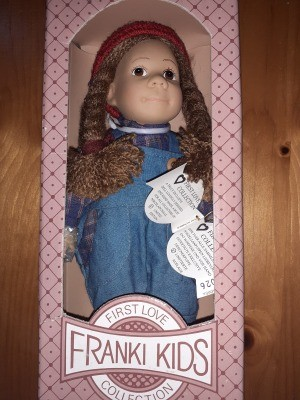 Value of a Franki Kids First Love Collection Porcelain Doll?