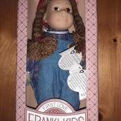A doll in a box.