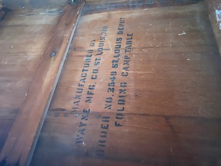 Markings on the underside of the table.