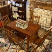 Value and Age of a Vintage Folding Camp Table?  - table and chairs in a shop