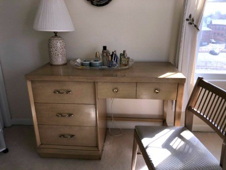 A bedroom desk with drawers.