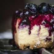 A delicious slice of blueberry cheesecake.