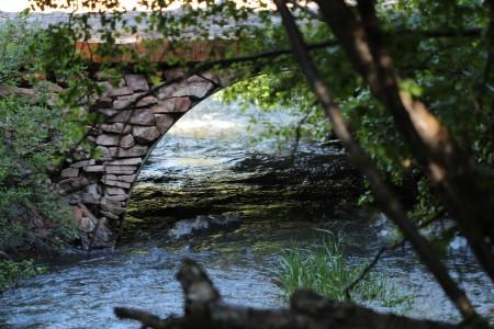 A rock bridge over a creek.