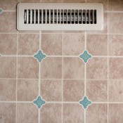 A linoleum floor with an air vent.