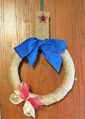 Simple and Fun Burlap Wrapped Country Wreath - wreath hanging on a door
