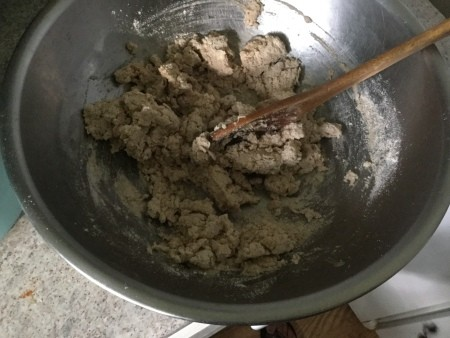 The pie crust mixture in a bowl.
