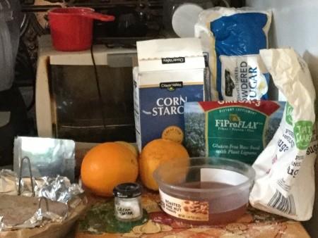 Ingredients for making vegan orange meringue pie.